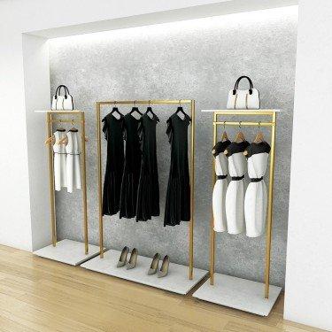 Portant doré, portant laiton, portant vêtement doré et or pour agencement de magasin design, élégant, baroque